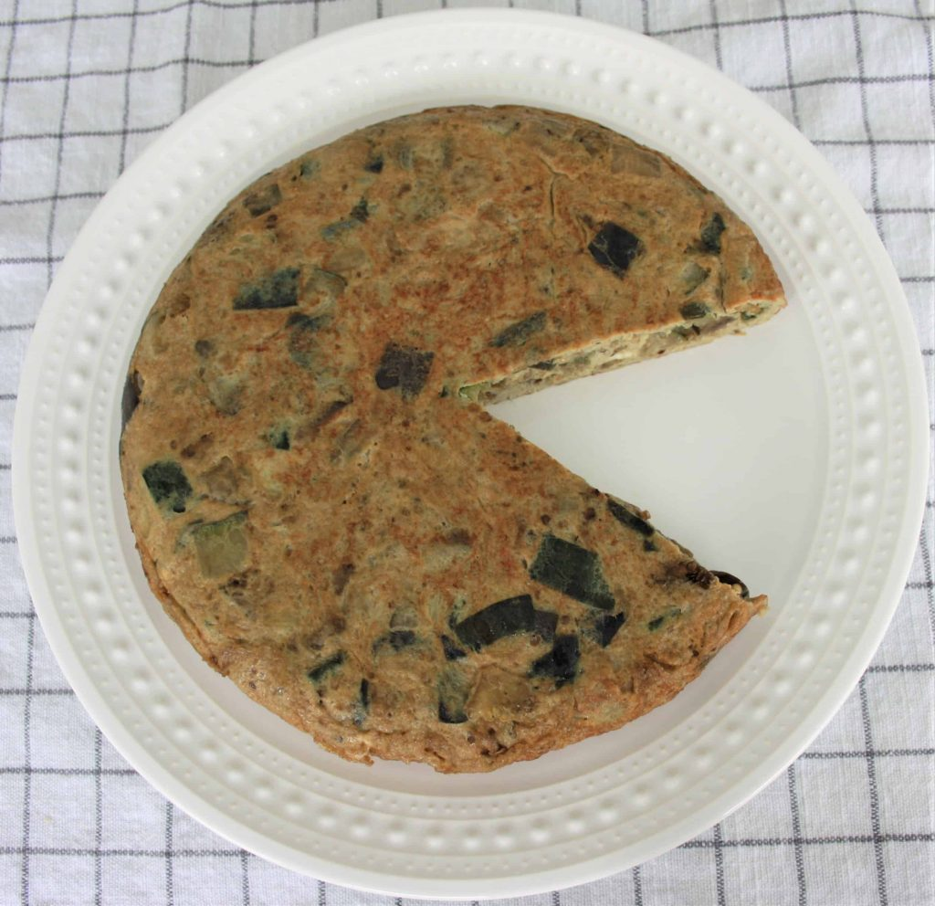 zucchini and eggplant Spanish tortilla (omelette) in a plate with pacman shape