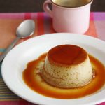 individual coffee flan with caramel on top and an expresso on the side