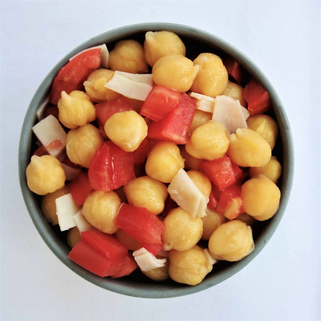 chickpeas, tomatoes and turkey breast in a small bowl
