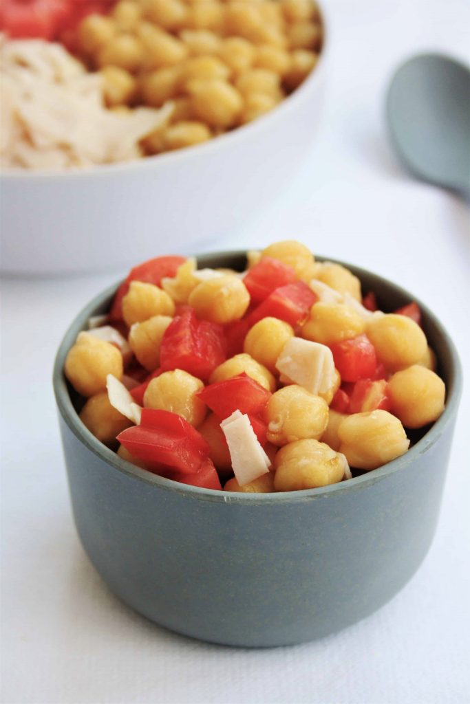chickpeas, tomatoes and turkey breast in a small grey bowl