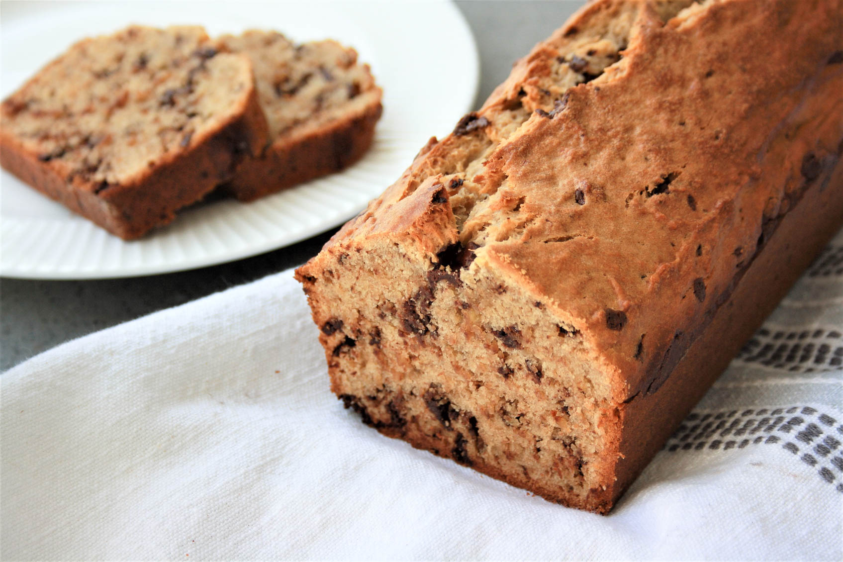 sliced loaf of chocolate peanut butter banana bread
