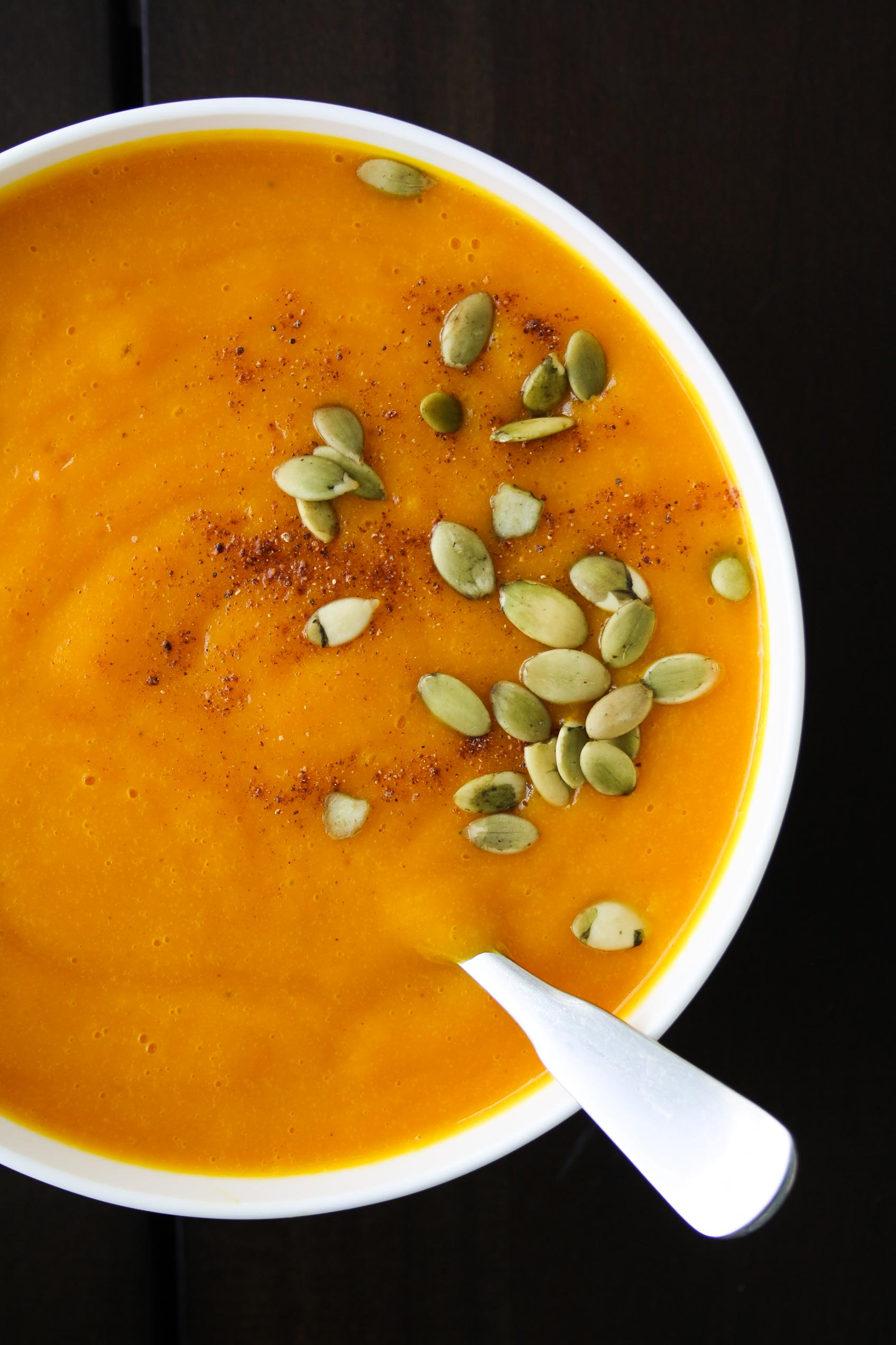 butternut squash soup topped with pumpkin seeds and nutmeg