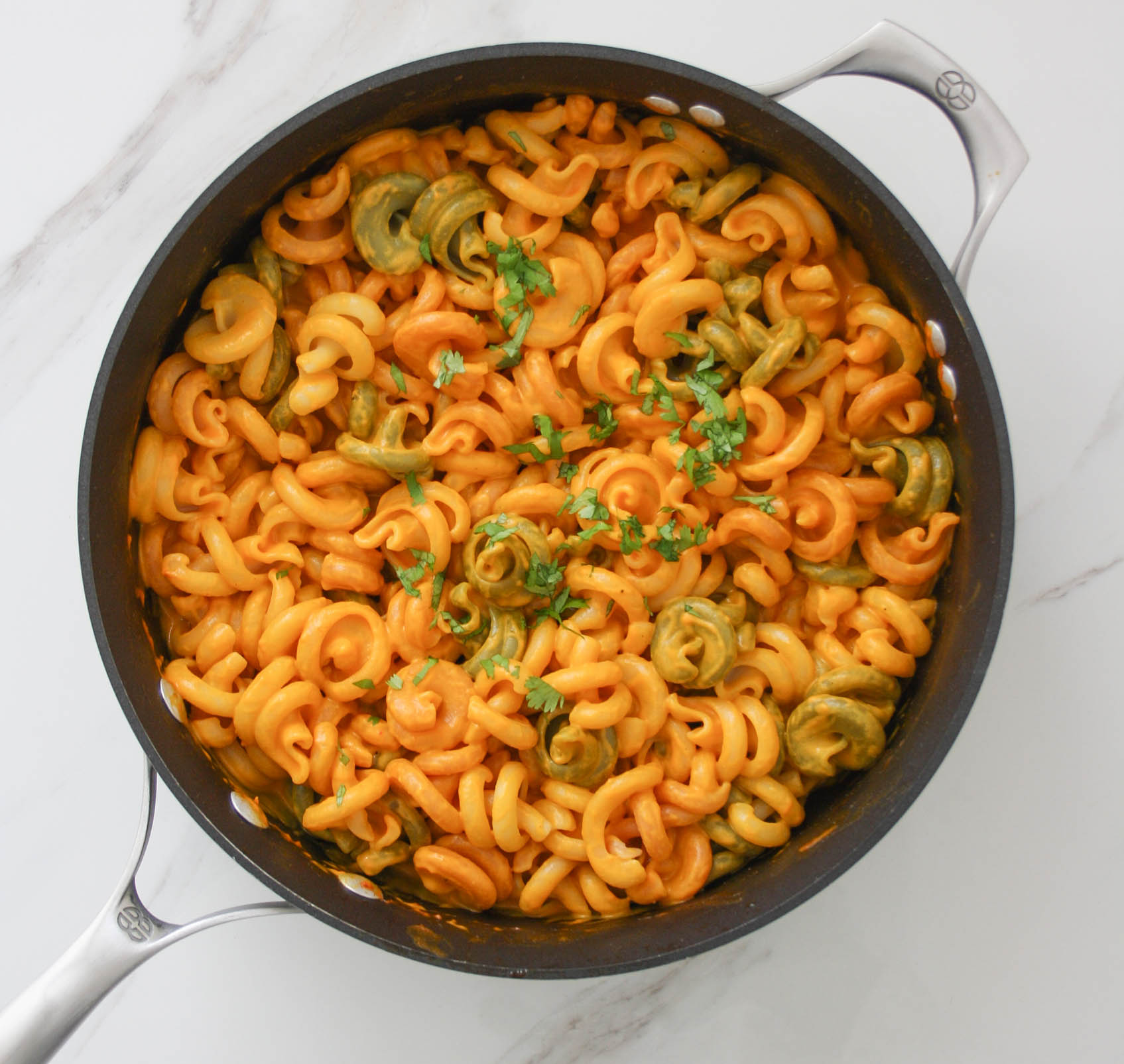 pasta with bell pepper sauce in the cooking pan