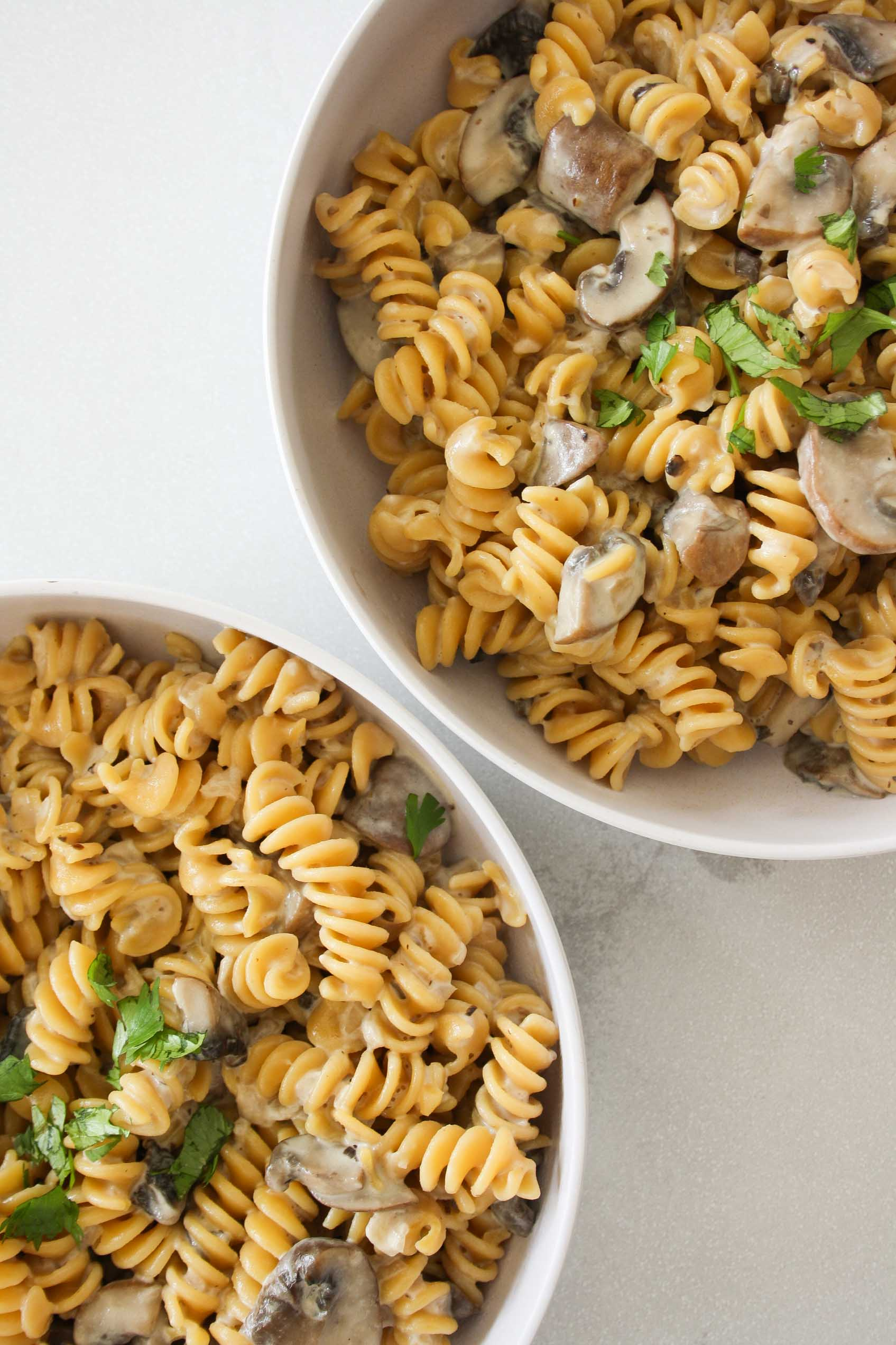 chickpea pasta with creamy mushroom sauce in two bowls