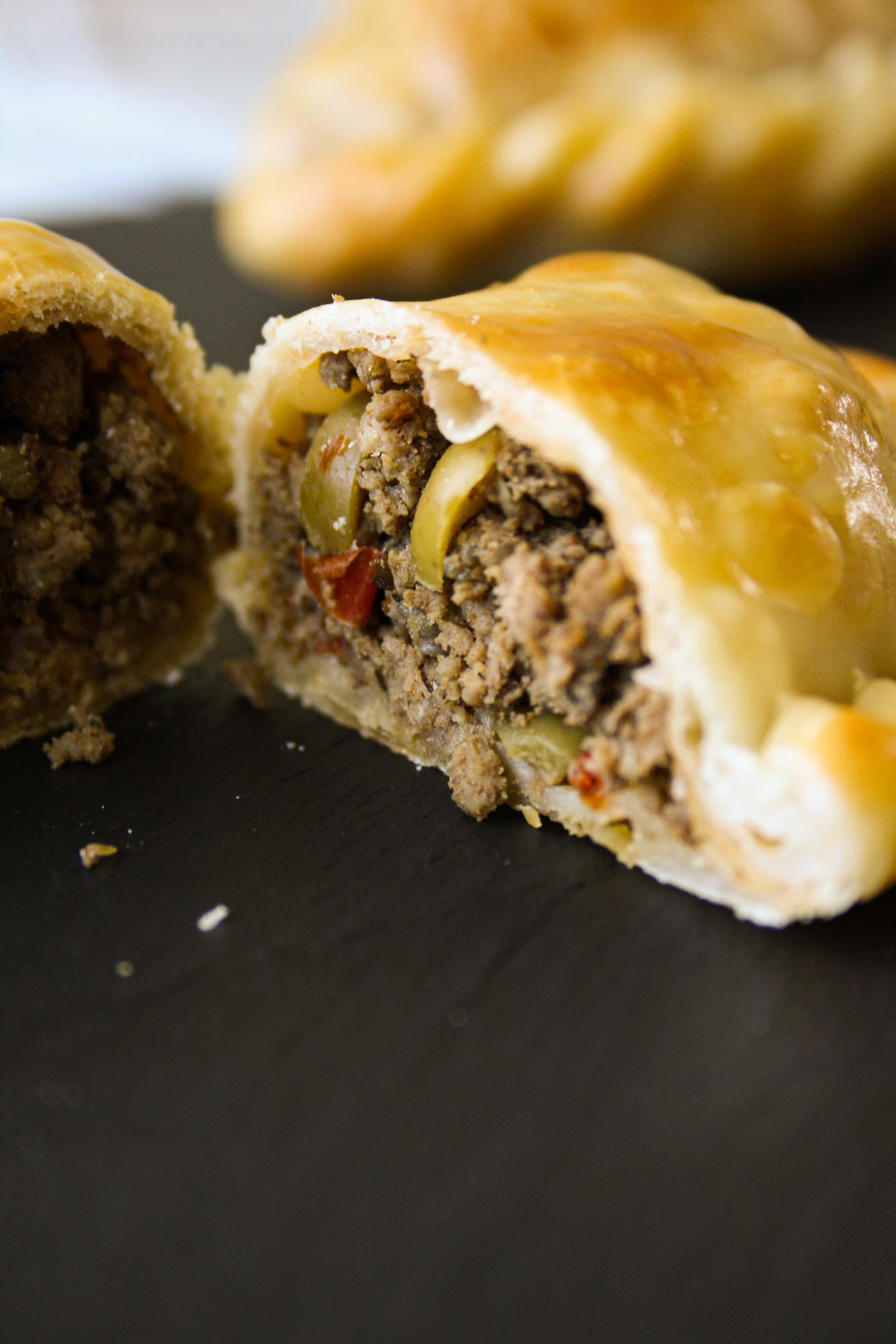 close up of the inside of a beef empanada cut in half