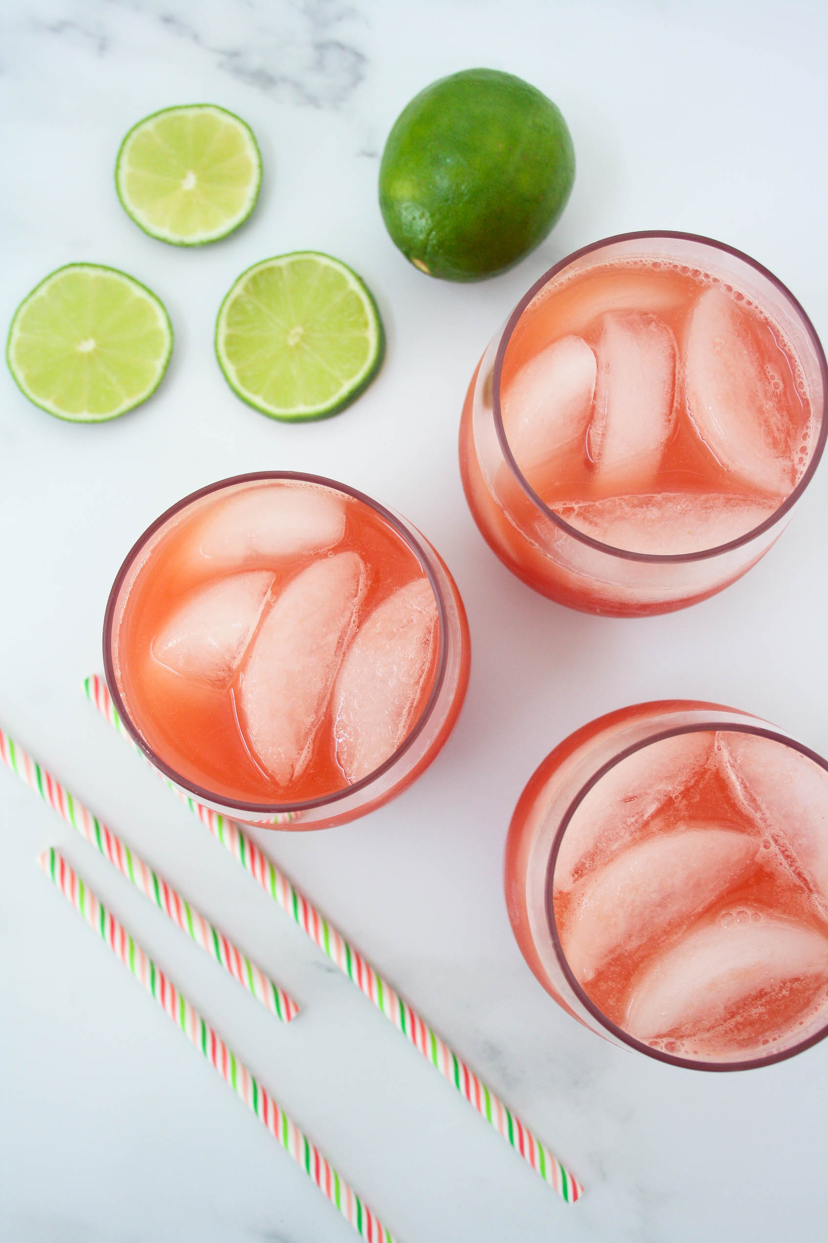 view from avobe of three glasses of watermelon limeade