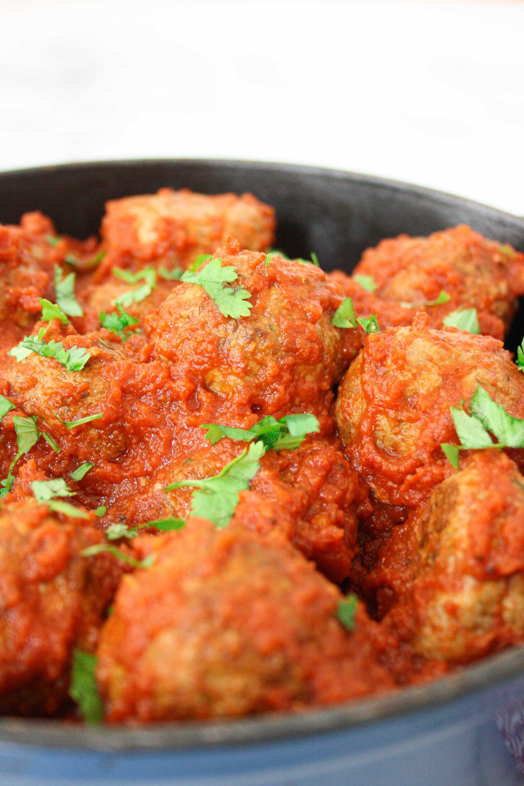close up of meatballs in tomato sauce