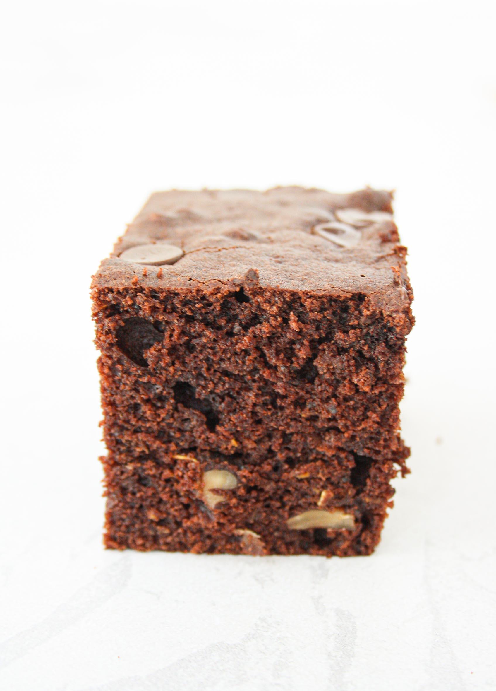close up of a square slice of chocolate zucchini cake
